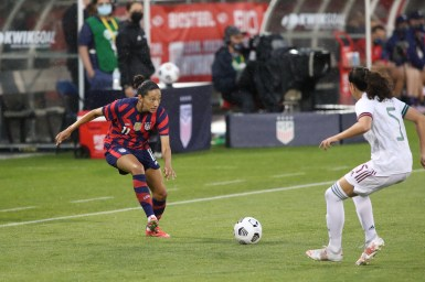 USWNT forward Christen Press (11) passes the ball in the first of two 2021 WNT Send-Off Series games between the USWNT and Mexico at Rentschler Field in East Hartford, CT on July 1, 2021.