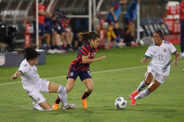 USWNT defender Kelley O'Hara (5) takes on Team Mexico players Jimena Lopez (5) and Maria Sanchez (11) in the first of two 2021 WNT Send-Off Series games between the USWNT and Mexico at Rentschler Field in East Hartford, CT on July 1, 2021.