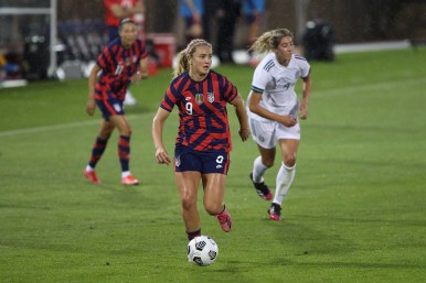USWNT midfielder Lindsey Horan (9) dribbles the ball down the field in the first of two 2021 WNT Send-Off Series games between the USWNT and Mexico at Rentschler Field in East Hartford, CT on July 1, 2021.