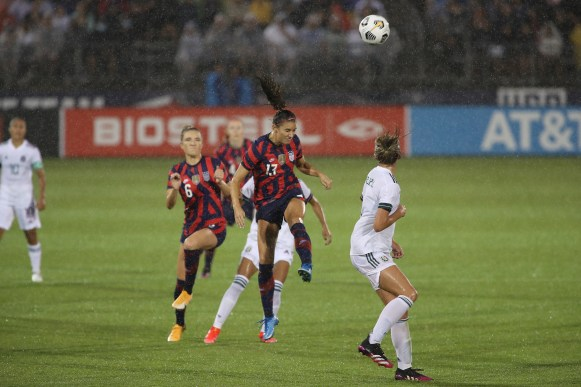 USWNT forward Alex Morgan (13) heads the ball in the first of two 2021 WNT Send-Off Series games between the USWNT and Mexico at Rentschler Field in East Hartford, CT on July 1, 2021.