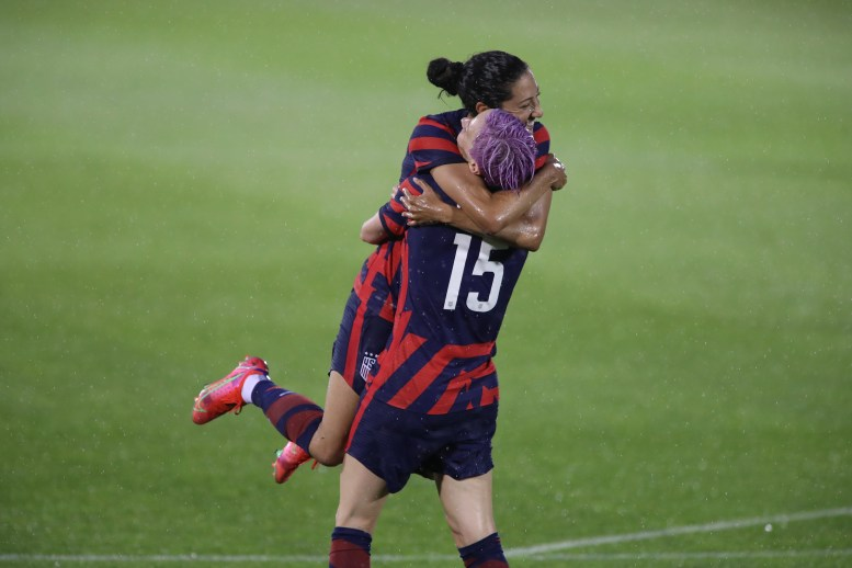 USWNT forward Christen Press (11) celebrates her goal with teammate Megan Rapinoe (15) in the first of two 2021 WNT Send-Off Series games between the USWNT and Mexico at Rentschler Field in East Hartford, CT on July 1, 2021.