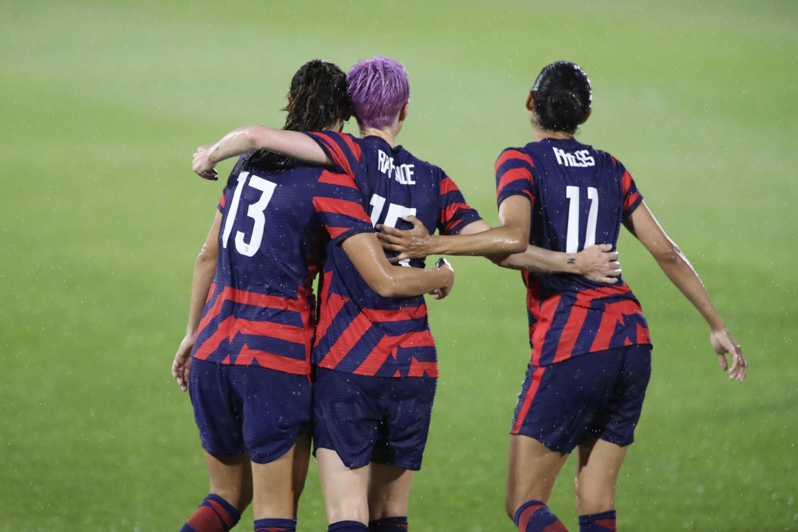 USWNT team members Alex Morgan (13), Megan Rapinoe (15), and Christen Press (11) in the first of two 2021 WNT Send-Off Series games between the USWNT and Mexico at Rentschler Field in East Hartford, CT on July 1, 2021.
