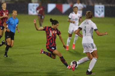 USWNT forward Christen Press (11) takes a shot on goal in the first of two 2021 WNT Send-Off Series games between the USWNT and Mexico at Rentschler Field in East Hartford, CT on July 1, 2021.