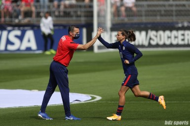 USWNT head coach Vlatko Andonovski high fives midfielder Tobin Heath (7) in the second of two 2021 WNT Send-Off Series games between the USWNT and Mexico at Rentschler Field in East Hartford, CT on July 5, 2021.