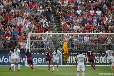 USWNT goalkeeper Alyssa Naeher (1) ensures the ball goes over the crossbar in second of two 2021 WNT Send-Off Series games between the USWNT and Mexico at Rentschler Field in East Hartford, CT on July 5, 2021.