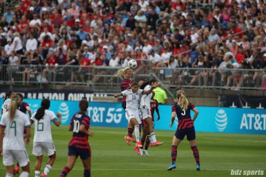 USWNT midfielder Lindsey Horan (9) leaps over Team Mexico midfielder Nancy Antonio (16) to head the ball in the second of two 2021 WNT Send-Off Series games between the USWNT and Mexico at Rentschler Field in East Hartford, CT on July 5, 2021.