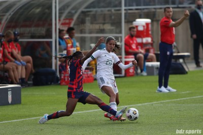 USWNT defender Crystal Dunn (2) tackles the ball away from Team Mexico forward Alison Gonzalez (20) in the second of two 2021 WNT Send-Off Series games between the USWNT and Mexico at Rentschler Field in East Hartford, CT on July 5, 2021.