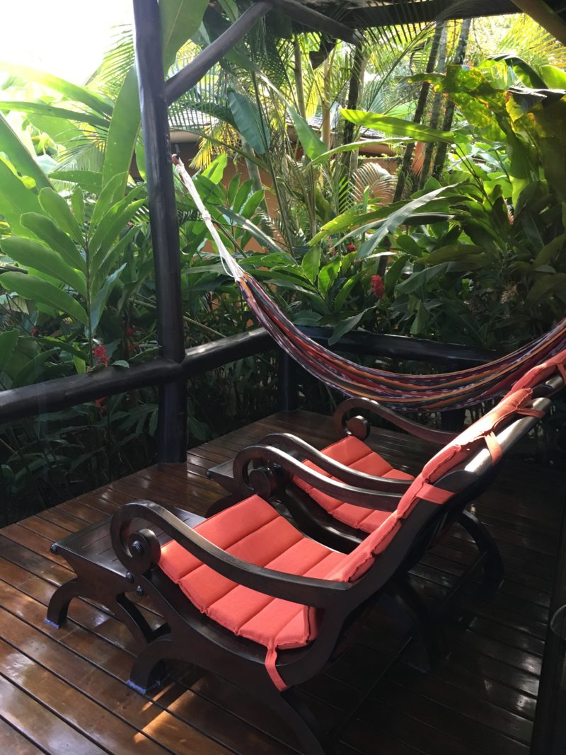 The super swish Nayara Resort chairs and hammock on terrace