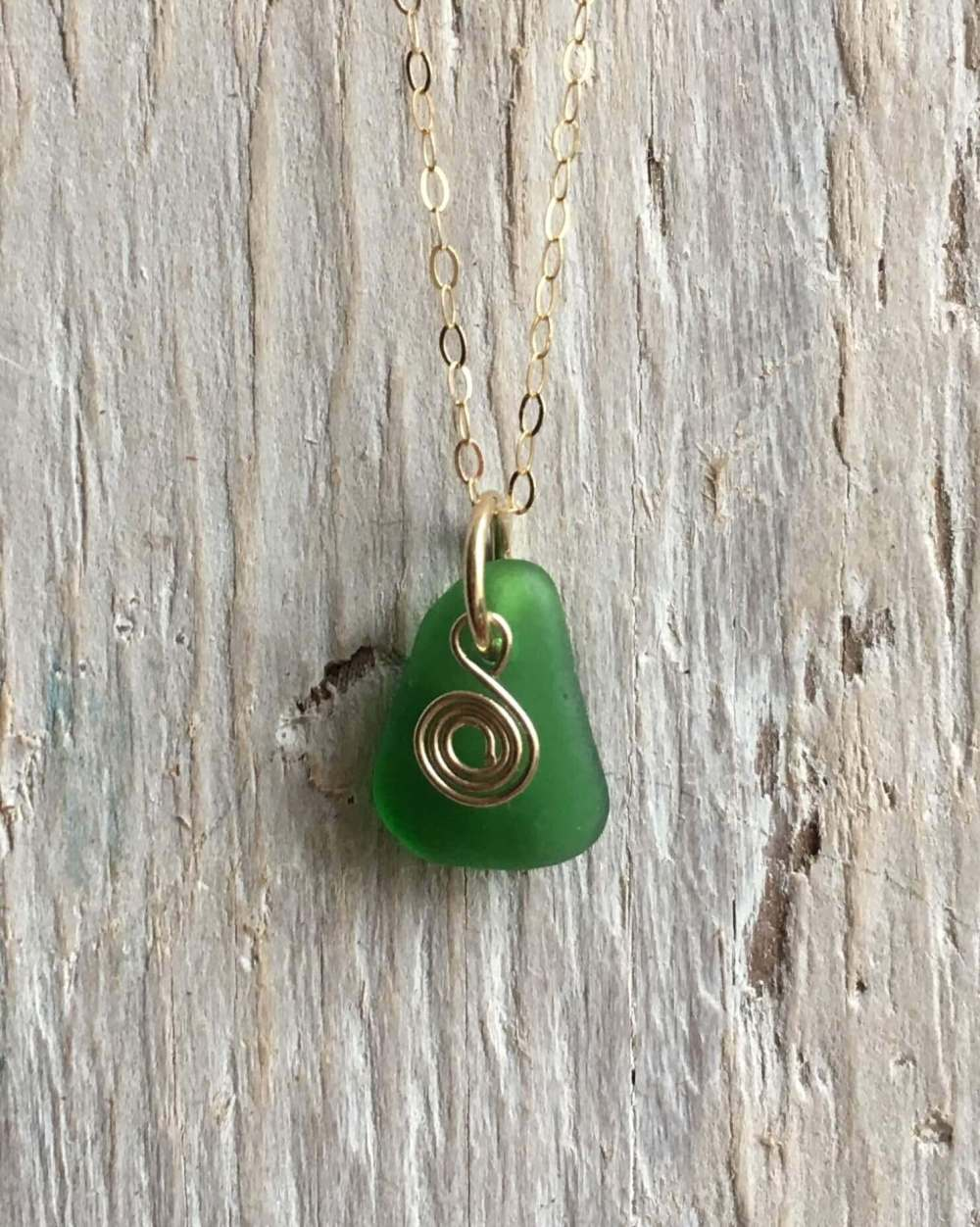 green sea glass with recycled gold spiral
