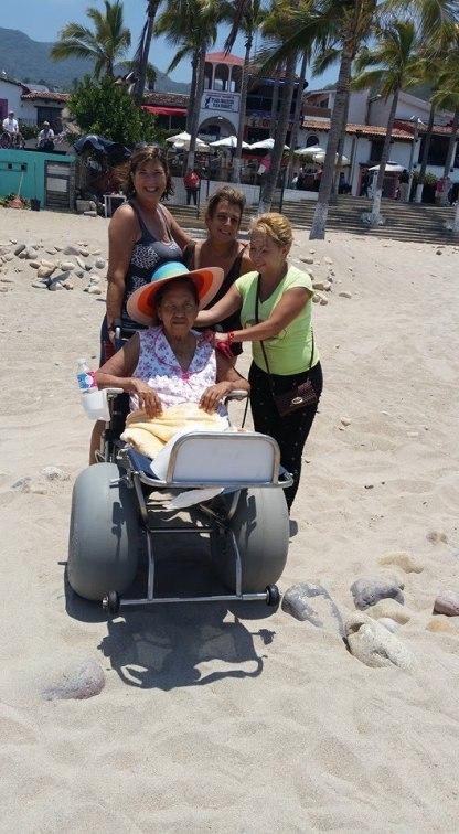 Helping with a beach wheelchair.