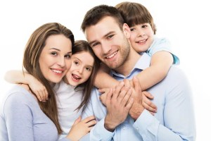 a family with a beautiful smile because they chose a great family dentist