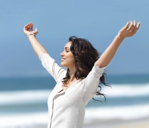 women with her arms up image