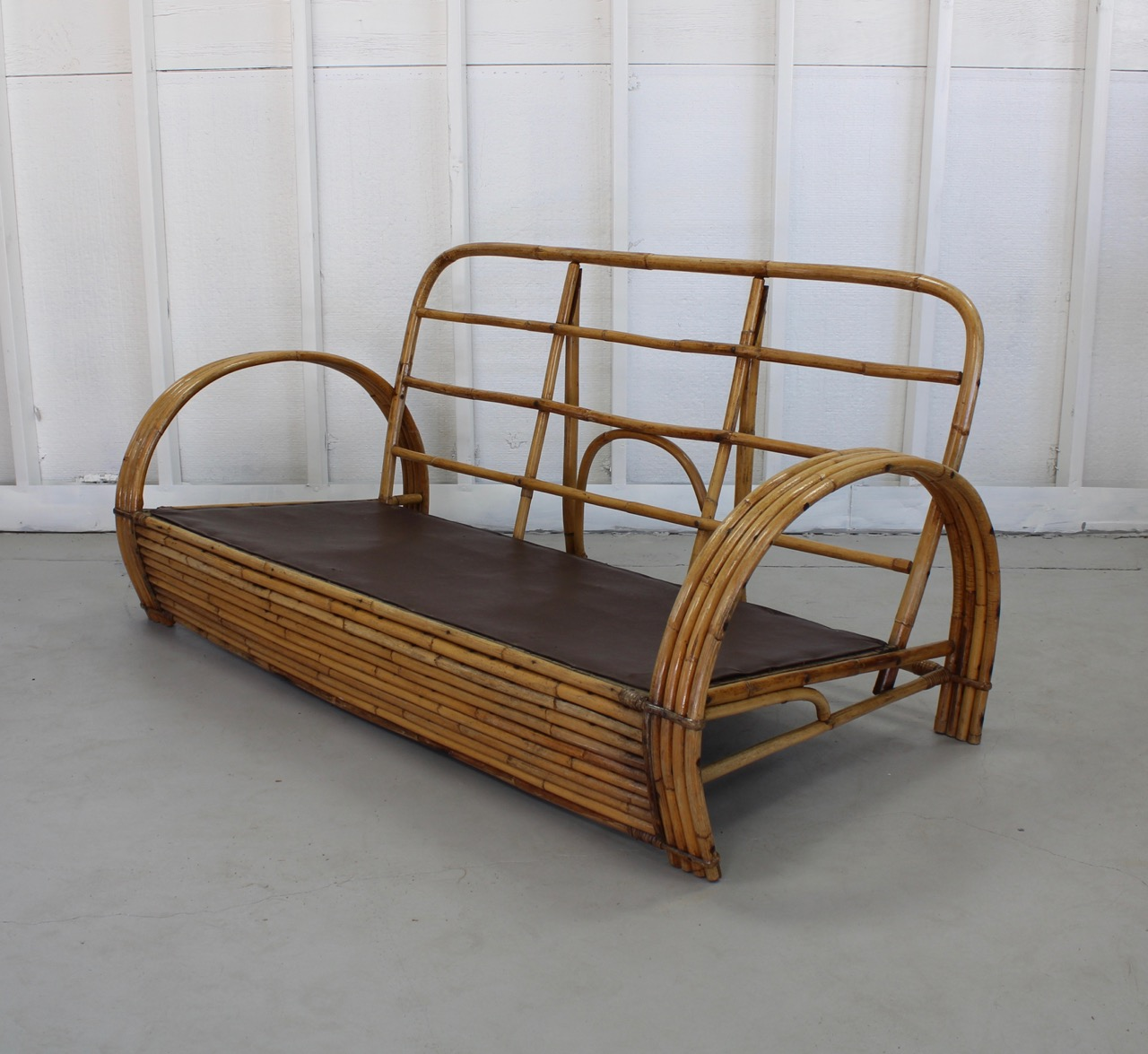 Vintage Rattan Sofa in classic  curvy  stacked design
