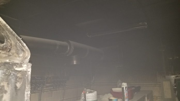 The smoke filled utility room where the fire took place.