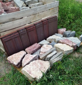 Stone for north wall of house from Michigan quarries; roof tile from Ohio