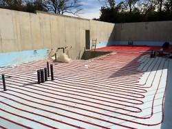 House lower level radiant floor installation