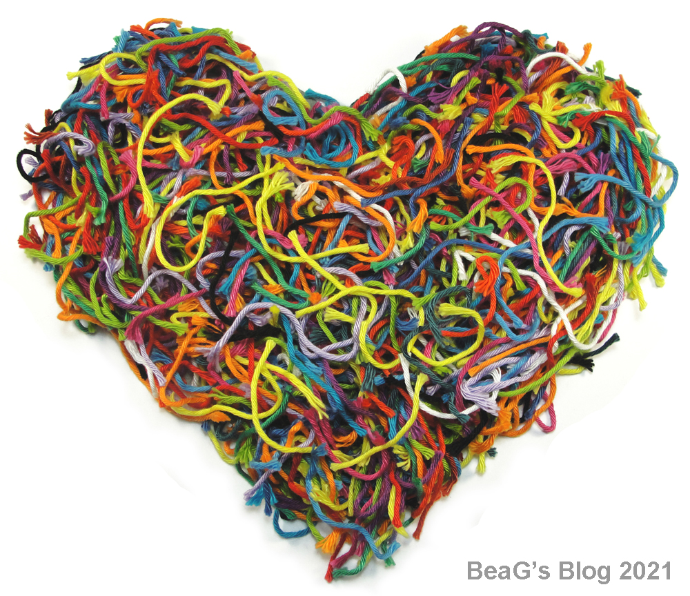 Heart of colorful yarn scraps.