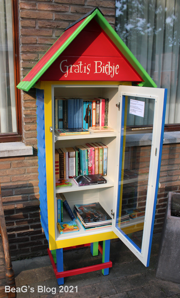 Close-up picture of colorful Little Free Library (Gratis Biebje) in front of our home.