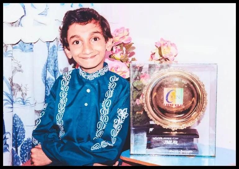 Sai-Kaustuv-Dasgupta-in-his-childhood-with-an-award-Be-An-Inspirer