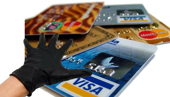 Gloved hand that is reaching for banking and credit info