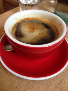 Long Black coffee in a red cup