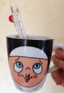 thermometer in a nun mug