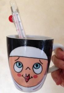 thermometer in a nun mug