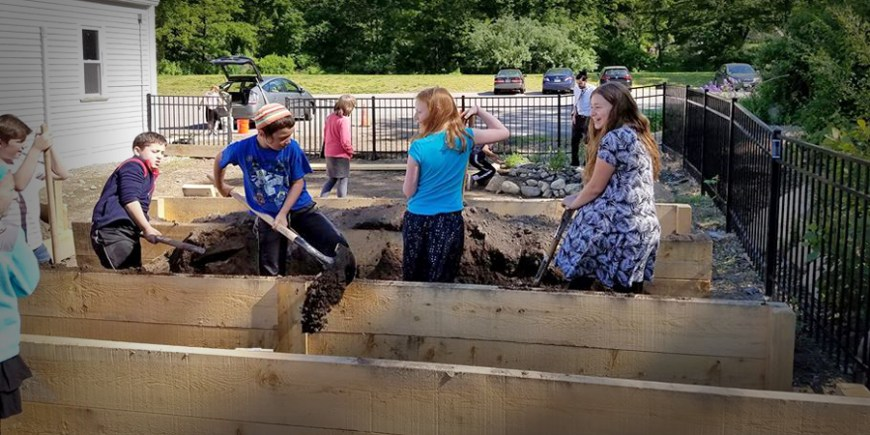 Students filling raised beds at Jewish educational garden at SHAS