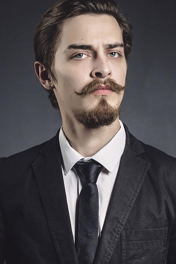 Handlebar mustache with a goatee