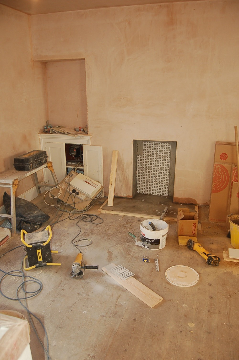Hearth Tiles going in