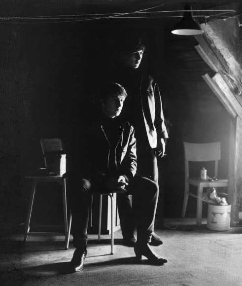 John Lennon and George Harrison in Stuart Sutcliffe's art studio at Astrid Kirchherr's house, 1962