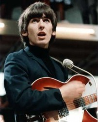 George Harrison with his 12 string Rickenbacker performing live with The Beatles