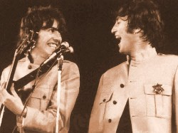 George Harrison and John Lennon having a laugh in Shea Stadium