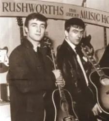 John Lennon & George Harrison looking at guitars at Rushworths Music Store