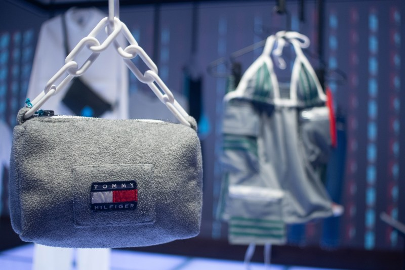 A sustainable Tommy Hilfiger bag hangs on display in the Fashion for Good Museum main room on the ground floor