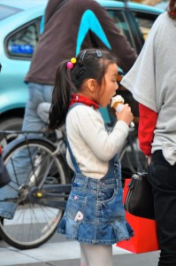 © Beatrice Otto Shanghai girl eating ice cream