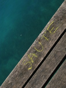 Chalk writing on wooden quay