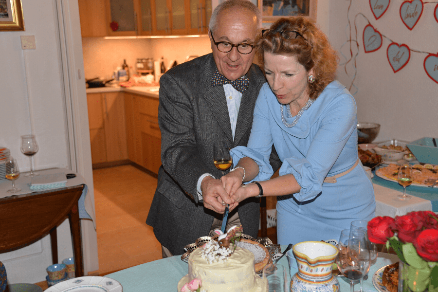 Cutting the cake ... God it was good, complemented by Anne-Catherine's Linzertorte & Claudine's almond tart