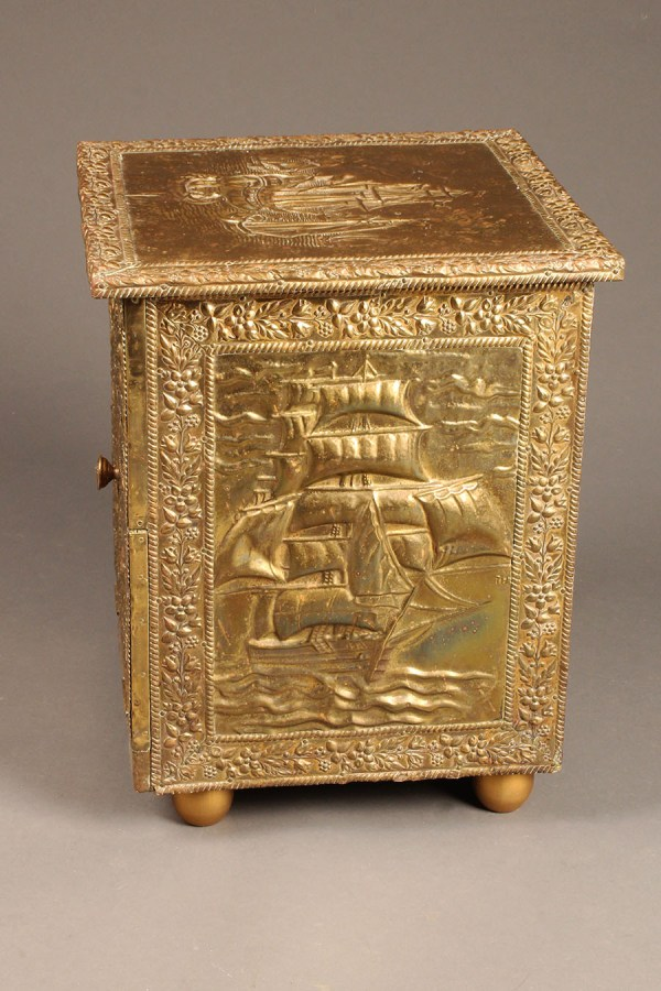 Antique English repoussed brass fireside box.