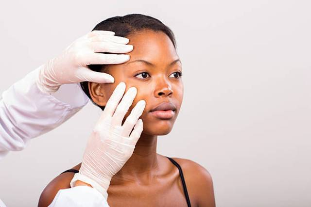 see a dermatologist for an even skin tone