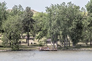 Trees surround Lake Ilo park and the fishing dock