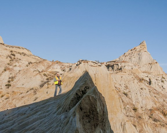 Wearing a reflective orange safety vest is a good idea hiking the badlands in the fall.