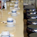 coffee cups in a row in a cafe