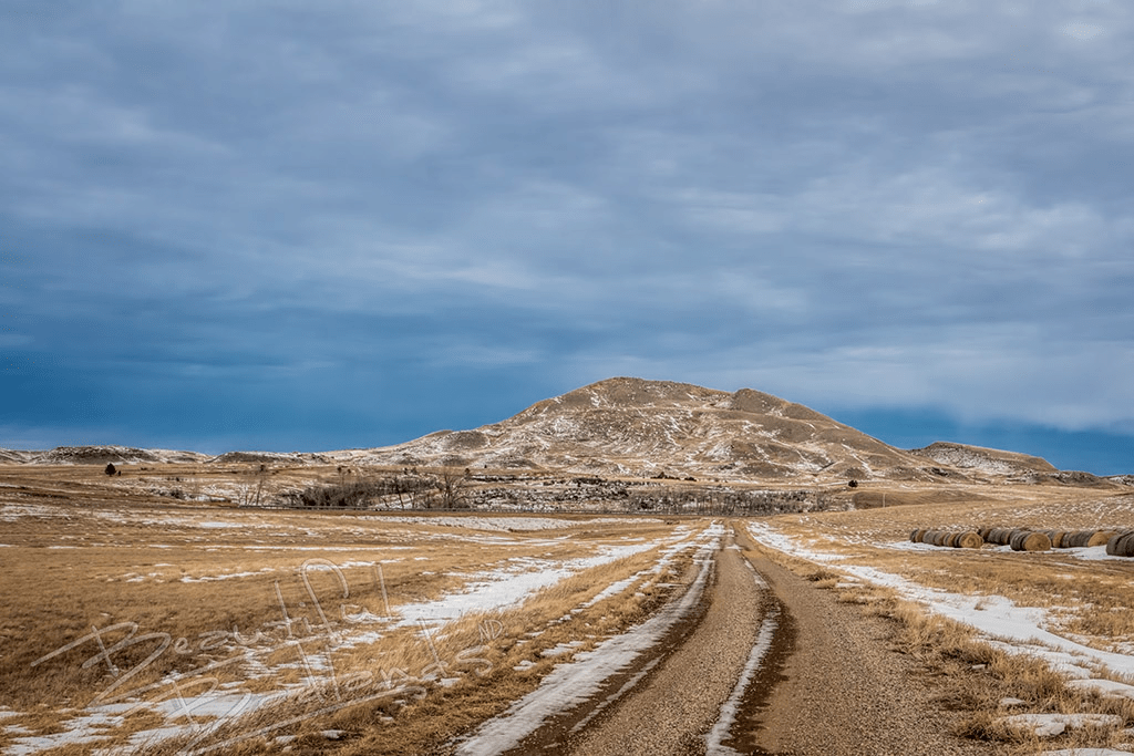 Camel Hump Butte in the winter with a gravel road