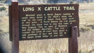 Longhorns on the Long X trail are centered at this sign in the TRNP.