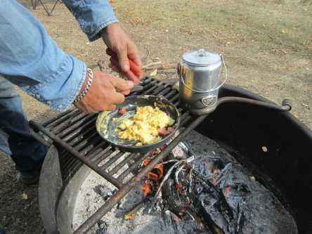 Campfire cooking, scrambled eggs and coffee prepared on the campfire rings at Elkhorn Ranch are a great way to begin the day!