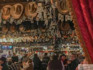 Happy People and Cowboy Hats and Dollar Bills! Little Missouri Saloon & Dining in Medora, North Dakota!