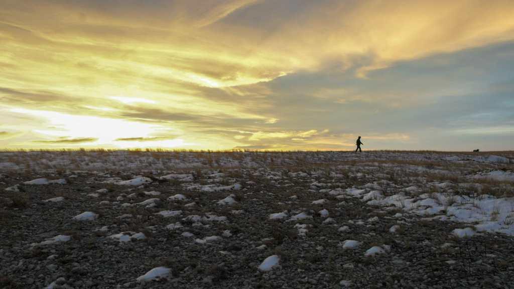 Still Hiking As the Sun Sets At Square Butte, North Dakota Badlands
