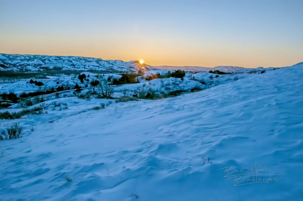 The sun began to set in the west as the golden hour shifted to the blue hour.  Our day of winter exploration in the Beautiful Badlands was coming to an end on a winter perfect February day.