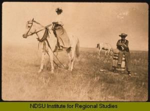 Ingeborg Isaacson, Adolph Thoen, hauling water in McKenzie County. Photo from NDSU Institute for Regional Studies.